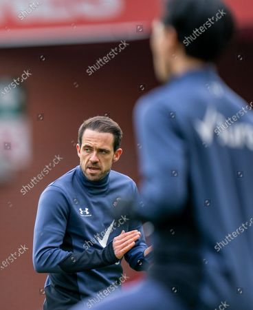 Danny Ings of Southampton encouraging team in warm up, framed by Takumi Minamino of Southampton; Bramall Lane, Sheffield, Yorkshire, England; English Premier League Football, Sheffield United versus Southampton.