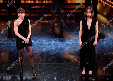 Stock Picture of Alessandra Amoroso (L) and Italian actress Matilde Gioli perform on stage at the Ariston theatre during  the 71st Sanremo Italian Song Festival, Sanremo, Italy, 05 March 2021. The festival runs from 02 to 06 March.