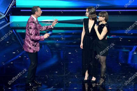 Sanremo Festival host and artistic director, Amadeus (L), Italian singer Alessandra Amoroso (R) and Italian actress Matilde Gioli (C) perform on stage at the Ariston theatre during the 71st Sanremo Italian Song Festival, Sanremo, Italy, 05 March 2021. The festival runs from 02 to 06 March.