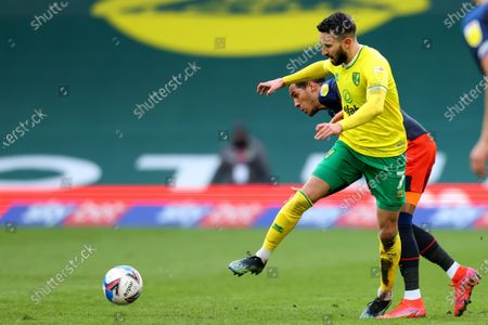 Stock Image of Lukas Rupp of Norwich City competes for the ball with Thomas Ince of Luton Town; Carrow Road, Norwich, Norfolk, England, English Football League Championship Football, Norwich versus Luton Town.