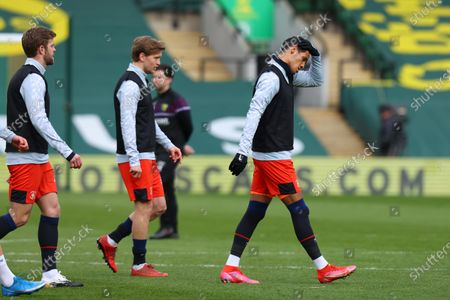 Stock Picture of Thomas Ince of Luton Town leads his team mates out to warm up; Carrow Road, Norwich, Norfolk, England, English Football League Championship Football, Norwich versus Luton Town.