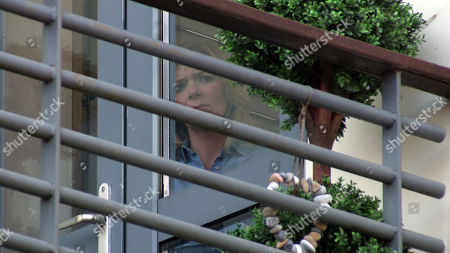 Coronation Street - Ep 10280 Monday 22nd March 2021 - 2nd Ep From her window, Leanne Tilsley, as played by Jane Danson, despairs as she watches Nick Tilsley, Natasha Blakeman and Sam Blakeman, looking to all intents the perfect family.