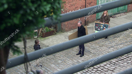Stock Image of Coronation Street - Ep 10280 Monday 22nd March 2021 - 2nd Ep From her window, Leanne Tilsley despairs as she watches Nick Tilsley, as played by Ben Price, Natasha Blakeman, as played by Rachel Leskovac, and Sam Blakeman, as played by Jude Riordan, looking to all intents the perfect family.