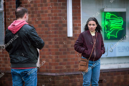 Stock Picture of Coronation Street - Ep 10269 Wednesday 10th March 2021 - 1st Ep After finding out her family dog back in Romania has died, Alina Pop, as played by Ruxandra Porojnicu, bursts into tears in the street. Tyrone Dobbs, as played by Alan Halsall, is sympathetic and tells Alina about his own dog Monica.