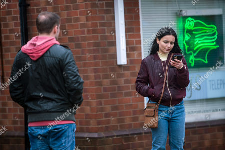Stock Image of Coronation Street - Ep 10269 Wednesday 10th March 2021 - 1st Ep After finding out her family dog back in Romania has died, Alina Pop, as played by Ruxandra Porojnicu, bursts into tears in the street. Tyrone Dobbs, as played by Alan Halsall, is sympathetic and tells Alina about his own dog Monica.