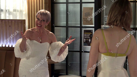 Stock Photo of Coronation Street - Ep 10275 Wednesday 17th March 2021 - 1st Ep Debbie Webster, as played by Sue Devaney, invites Abi Franklyn, as played by Sally Carman, and Sally to the bistro where she's provided drinks and a selection of wedding dresses to try. Abi reluctantly tries on the dresses whilst Tracy knocks back the wine and mocks Debbie's taste. Eventually Abi tells Debbie she doesn't want her charity but as their row escalates, Debbie accidentally sits on some food, staining one of the dresses.