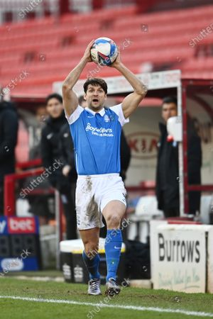 George Friend of Birmingham City takes a throw in.