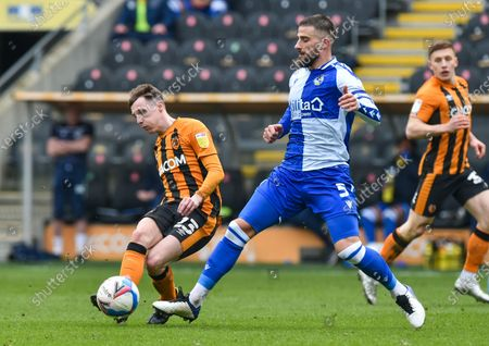 Gavin Whyte of Hull City and Max Ehmer of Bristol Rovers