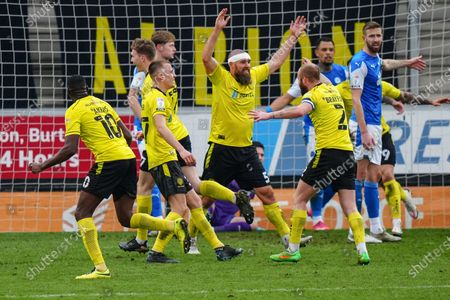 Michael Bostwick of Burton Albion and John Brayford of Burton Albion celebrate as Hayden Carter of Burton Albion scores a goal to make it 2-0