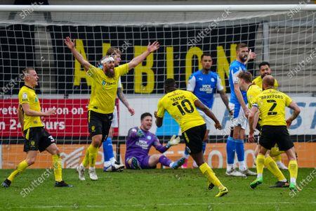 Michael Bostwick of Burton Albion celebrates as Hayden Carter of Burton Albion scores a goal to make it 2-0