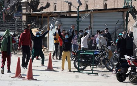 Stock Picture of Protestors react during clashes with police outside the Jamia Masjid following Friday prayers in Srinagar, India, 05 March 2021. Clashes erupted between demonstrators and policemen during a protest against the detention of separatist leader and Kashmir's Chief cleric Mirwaiz Umar Farooq, under house arrest since August 2019.