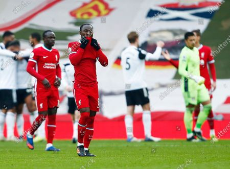 Naby Keita of Liverpool looks dejected at the end of the game