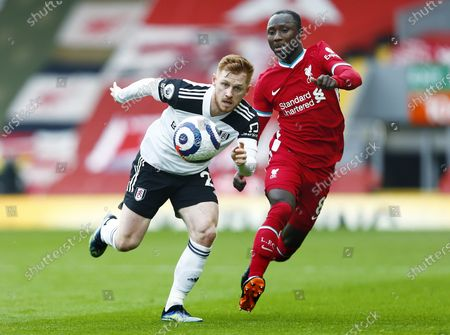 Harrison Reed of Fulham and Naby Keita of Liverpool