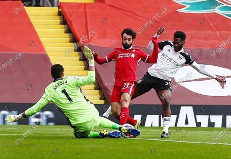 Fulham goalkeeper Alphonse Areola makes a save from Mohamed Salah of Liverpool