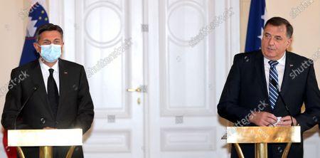 Slovenian President Borut Pahor (L) and Chairman of Bosnian Presidency, Milorad Dodik (R), speak during a press conference after a meeting in Sarajevo, Bosnia and Herzegovina, 05 March 2021. Borut Pahor arrived for a working visit to Bosnia and Herzegovina.