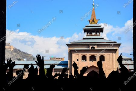 Kashmiri protesters gesturing during the demonstration.Protesters demonstrate against the continuous detention of Kashmiri separatist leader and Chief Cleric Mirwaiz Umar Farooq, who is under house detention since August 2019, when India scrapped the region's semi-autonomous status.