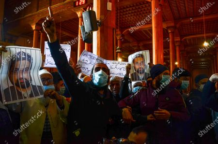 A Kashmiri protester gestures and shouts slogans during the demonstration.Protesters demonstrate against the continuous detention of Kashmiri separatist leader and Chief Cleric Mirwaiz Umar Farooq, who is under house detention since August 2019, when India scrapped the region's semi-autonomous status.