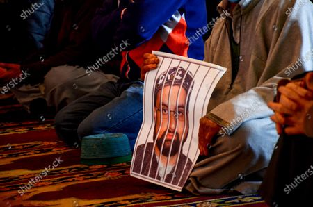A Kashmiri protester holds a portrait of Hurriyat chairman and Valleyís chief cleric Mirwaiz Umar Farooq during the demonstration.Protesters demonstrate against the continuous detention of Kashmiri separatist leader and Chief Cleric Mirwaiz Umar Farooq, who is under house detention since August 2019, when India scrapped the region's semi-autonomous status.