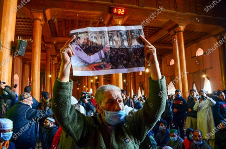 A Kashmiri protester holds a portrait of Hurriyat chairman and Valleyís chief cleric Mirwaiz Umar Farooq, during the demonstration.Protesters demonstrate against the continuous detention of Kashmiri separatist leader and Chief Cleric Mirwaiz Umar Farooq, who is under house detention since August 2019, when India scrapped the region's semi-autonomous status.