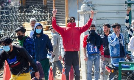A Kashmiri protester gestures and shouts pro-freedom slogans during the demonstration.Protesters demonstrate against the continuous detention of Kashmiri separatist leader and Chief Cleric Mirwaiz Umar Farooq, who is under house detention since August 2019, when India scrapped the region's semi-autonomous status.