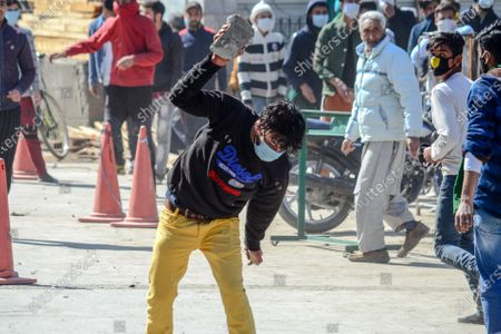 A Kashmiri protester seen breaking a stone during the demonstration.Protesters demonstrate against the continuous detention of Kashmiri separatist leader and Chief Cleric Mirwaiz Umar Farooq, who is under house detention since August 2019, when India scrapped the region's semi-autonomous status.