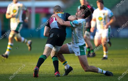 Mike Brown of Harlequins leads with a forearm to fend off George Furbank of Northampton's tackle