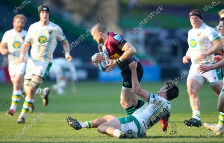 Mike Brown of Harlequins tackled by George Furbank of Northampton