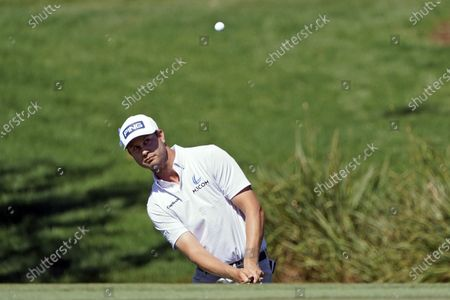 Harris English chips onto the second green during the second round of the Arnold Palmer Invitational golf tournament, in Orlando, Fla