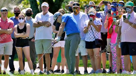 Zach Johnson hits from in front of the gallery just off the fairway on the 18th hole during the second round of the Arnold Palmer Invitational golf tournament, in Orlando, Fla