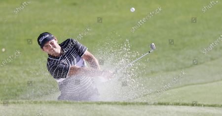 Patrick Reed of the US hits out of a bunker on the fifteenth hole during the second round of the Arnold Palmer Invitational presented by Mastercard golf tournament at the Bay Hill Club & Lodge in Orlando, Florida, USA, 05 March 2021.