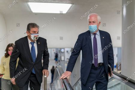 Sen. Joe Manchin, D-W.Va., left, and Sen. John Cornyn, R-Texas, head to the chamber as the Senate steers toward a voting marathon on the Democrats' $1.9 trillion COVID-19 relief bill that's expected to end with the chamber's approval of the measure, at the Capitol in Washington
