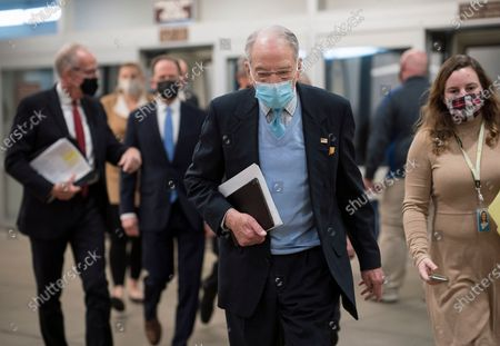 Sen. Chuck Grassley, R-Iowa, heads to the chamber as the Senate holds a voting marathon on the Democrats' $1.9 trillion COVID-19 relief bill that's expected to end with the chamber's approval of the measure, at the Capitol in Washington