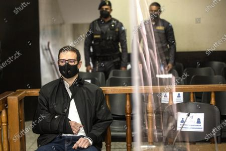 Luis Enrique Martinelli Linares (L), son of former Panamanian President Ricardo Martinelli (2009-2014), appears before a court to learn the reasons for his possible extradition to the United States, a country that required him for money laundering, in Guatemala City, Guatemala, 05 March 2021. Luis Enrique, 38, and his older brother, Ricardo Alberto Martinelli Linares, 40, were arrested in Guatemala on 06 July 2020 at the request of the United States for an extradition order due to the alleged crime of money laundering.