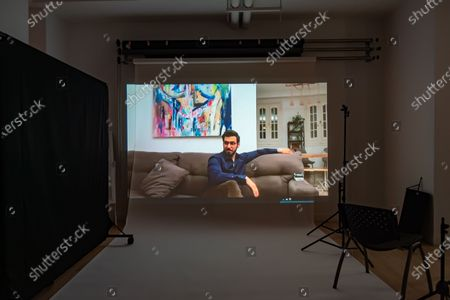 Exclusive - Captains of Zaatariposes' Ali El Arabi poses from a remote location for a portrait in a virtual studio in Shutterstock's headquarters in NYC's Empire State Building.