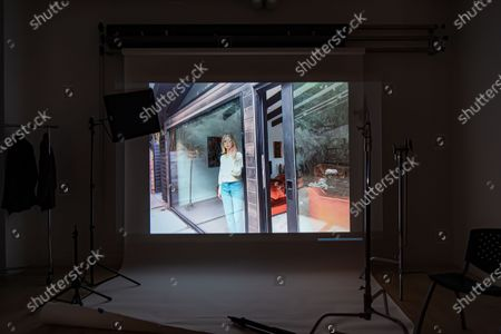 Stock Photo of Exclusive - The Blazing World's Carlson Young poses from a remote location for a portrait in a virtual studio in Shutterstock's headquarters in NYC's Empire State Building.
