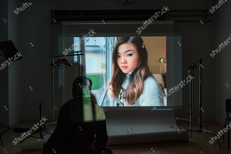 Stock Photo of Exclusive - Marvelous and the Black Hole's Miya Cech poses from a remote location for a portrait in a virtual studio in Shutterstock's headquarters in NYC's Empire State Building.