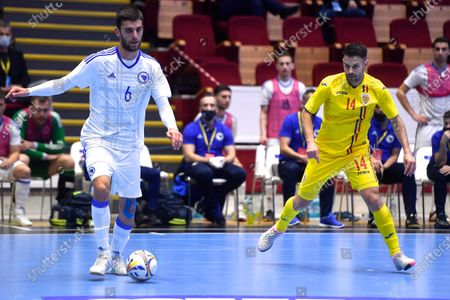 Srdjan Ivankovic of BIH in action against Paulo Ferreira of Romania during the European Futsal Championship 2022 qualification match between Romania - Bosnia and Herzegovina, on March 4, 2021 in Bucharest, Romania.