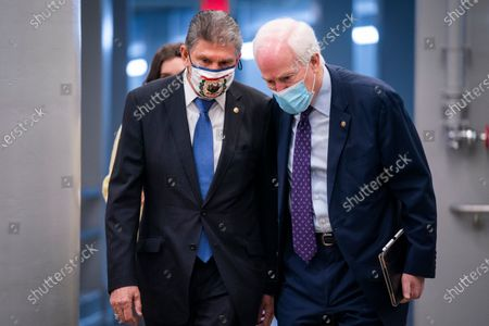 Stock Photo of Democratic Senator from West Virginia Joe Manchin (L) and Republican Senator from Texas John Cornyn (R) walk to the Senate chamber as the Senate begins a so-called 'vote-a-rama' on more than 40 amendments to President Biden's Covid relief package in the US Capitol in Washington, DC, USA, 05 March 2021. Once the Senate finishes with their marathon reconciliation process, they can vote on the final package.