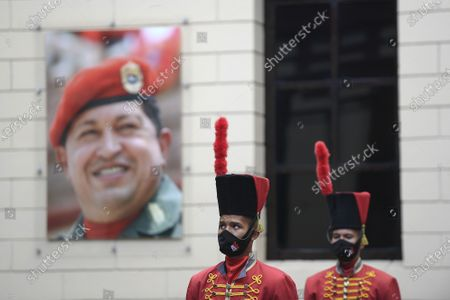 Honor guards stand by the tomb of late President Hugo Chavez at the Historic Military Museum on the eighth anniversary of his death in Caracas, Venezuela, . Chavez continues to unleash mixed feelings among Venezuelans: some remember him as the father of a revolution that defended the poor, while others blame him for the deep and prolonged crisis that overwhelms the South American country