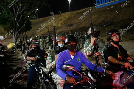 Security forces take part in a military drill to mark the eighth death anniversary of President Hugo Chavez in Caracas, Venezuela, late