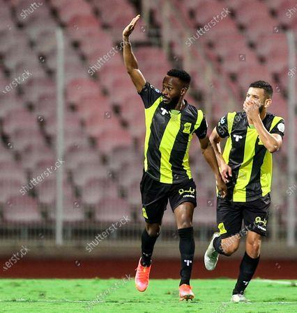 Al-Ittihad's player Fahad Al Muwallad (L) celebrates after scoring a goal during the Saudi Professional League soccer match between Al-Ittihad and Al-Wehda at King Abdulaziz Stadium, in Mecca, Saudi Arabia, 05 March 2021.