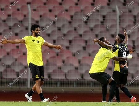 Al-Ittihad's player Fahad Al Muwallad (R) celebrates with teammates after scoring a goal during the Saudi Professional League soccer match between Al-Ittihad and Al-Wehda at King Abdulaziz Stadium, in Mecca, Saudi Arabia, 05 March 2021.