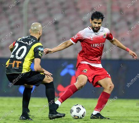 Al-Ittihad's player Karim El Ahmadi (L) in action against Al-Wehda's Alaa Al-Hejji (R) during the Saudi Professional League soccer match between Al-Ittihad and Al-Wehda at King Abdulaziz Stadium, in Mecca, Saudi Arabia, 05 March 2021.