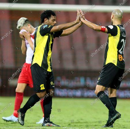 Al-Ittihad's player Romarinho (L) high fives teammate Karim El Ahmadi (R) after winning the Saudi Professional League soccer match between Al-Ittihad and Al-Wehda at King Abdulaziz Stadium, in Mecca, Saudi Arabia, 05 March 2021.