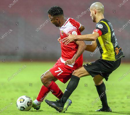 Al-Ittihad's player Karim El Ahmadi (R) in action against Al-Wehda's Ahmed Abdoh Jaber (L) during the Saudi Professional League soccer match between Al-Ittihad and Al-Wehda at King Abdulaziz Stadium, in Mecca, Saudi Arabia, 05 March 2021.