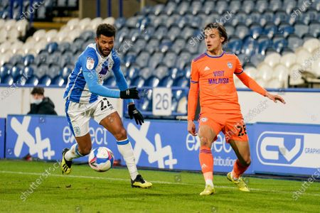 Cardiff City midfielder Tom Sang (28) and Huddersfield Town forward Fraizer Campbell (22) during the EFL Sky Bet Championship match between Huddersfield Town and Cardiff City at the John Smiths Stadium, Huddersfield