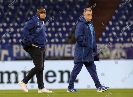 Schalke team manager Gerald Asamoah (L) and assistant coach Mike Buskens arrive for the German Bundesliga soccer match between FC Schalke 04 and FSV Mainz 05 in Gelsenkirchen, Germany, 05 March 2021.