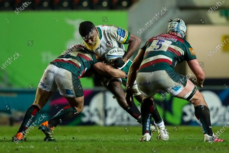 Albert Tuisue of London Irish is tackled by Tom Youngs of Leicester Tigers
