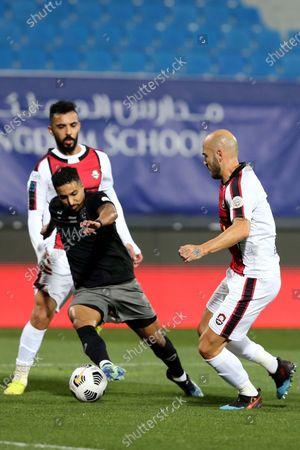 Stock Photo of Al-Hilal's player Salem Al-Dawsari (L) in action against Al-Raed's Nemanja Miletic (R) during the Saudi Professional League soccer match between Al-Hilal and Al-Raed at Prince Faisal Bin Fahd Stadium, in Riyadh, Saudi Arabia, 05 March 2021.