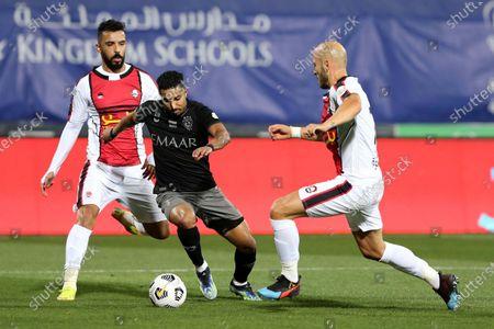 Al-Hilal's player Salem Al-Dawsari (2-L) in action against Al-Raed's Nemanja Miletic (R) during the Saudi Professional League soccer match between Al-Hilal and Al-Raed at Prince Faisal Bin Fahd Stadium, in Riyadh, Saudi Arabia, 05 March 2021.